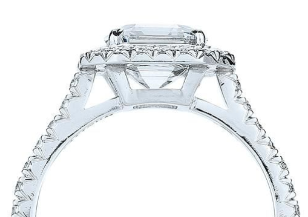 Gallery rail around diamond and side view of prongs of a Kwiat engagement ring