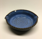 Brie baker shown her with Quinn's blue glaze inside and turtle shell glaze outside.
