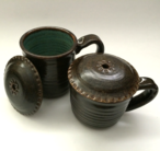 Chimney top mugs shown with turquoise inside and turtle shell outside.
