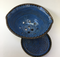 Colander with plate shown with quinn's blue inside and turtle shell outside.