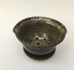 Berry bowl and plate shown here with iron lustre glaze inside and turtle shell outside.