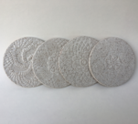 Set of 4 coasters shown in snow glaze.