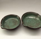 Small and large brie bakers are shown with turquoise glaze inside and turtle shell outside.