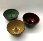 Apple bakers shown here with turquoise, goldenrod and burgundy glazes inside and turtle shell outside.