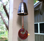 Cardinal bell made with upcycled leather.