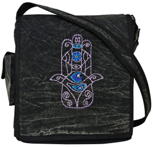 Hand embroidered Humsa on a flap bag with cell pocket