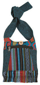 Small bag With front zip pocket and fringe. Beautiful mix of materials