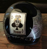 Vintage Motorcycle helmets with custom paint by Matt Dougan