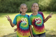 "Our fun ""Peace.Love.Twins"" tie-dye youth tee is the perfect twin set for summer! It's bursting with color and super soft. Also features our logo on the back neck line in white ink."