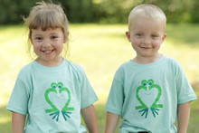 "Our ""Friendly Frog"" toddler t-shirt features our Friendly Frog, in green on a soft green tee."