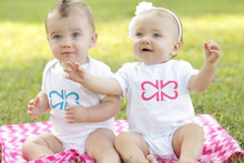 "My Twins Are Cuter ""Original"" twin bodysuit set with our logo, made of 2's, on the front. This design comes in pink ink and blue ink."