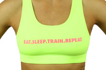 EAT. SLEEP. TRAIN. REPEAT  Sports Bra