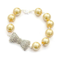 Pinup Yellow Pearl and Rhinestone Bow Bracelet by Juicy Lucy