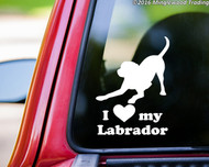 White labrador retriever silhouette in a playful stance with the words I love (heart symbol) my Labrador below. Custom vinyl decal by Minglewood Trading. Applied to the rear window of a truck.