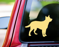 Ivory or cream custom vinyl decal of a silhouette of an Australian Cattle Dog applied to the rear window of a pickup truck. Made by Minglewood Trading.