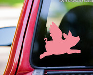 Soft pink custom vinyl decal of a silhouette of a Flying Pig applied to the rear window of a pickup truck. Made by Minglewood Trading.