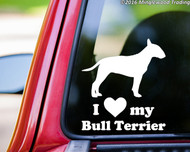 "White custom vinyl decal of a Bull Terrier with the words ""I love (heart symbol) my Bull Terrier"" beneath. By Minglewood Trading. Applied to the rear window of a truck."
