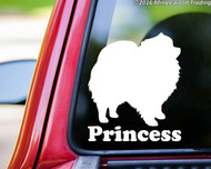 "White custom vinyl decal of a Pomeranian with the name ""Princess"" below. By Minglewood Trading. Applied to the rear window of an truck."