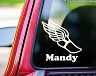 "White custom vinyl decal of a winged boot with the name ""Mandy"" below. By Minglewood Trading. Applied to the rear window of an truck."