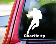 "White custom vinyl decal of a football player with the personalized name ""Charlie #9"" below. By Minglewood Trading. Applied to the rear window of a truck."