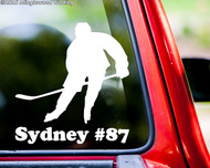 White custom vinyl decal sticker of a broomball player with the name Sydney and #87 underneath, by Minglewood Trading. Applied to the rear window of a truck