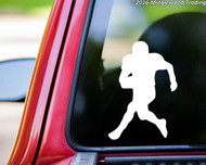 Custom white vinyl decal sticker of a football player by Minglewood Trading. Applied to the rear window of an truck.