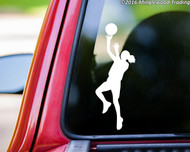 White custom vinyl decal of a female basketball player. By Minglewood Trading. Applied to the rear window of a truck.