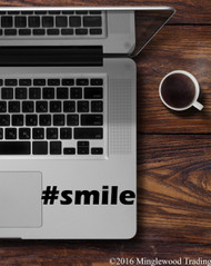 "Black ""#smile"" custom vinyl decal applied to the palmrest of a Macbook Pro. By Minglewood Trading."