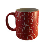 red ceramic starburst mug