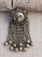 Pendant with bell Tassels