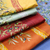 Yellow/Orange, Green, Red, Orange on top of a Blue Coated Olive Tree Tablecloth