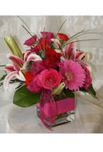 Hot Pink Chic Stargazer and Pink Rose Bouquet by Enchanted Florist Pasadena TX - Birthday flowers delivered daily in Houston, Pasadena, and surrounding southeast Harris county Texas RM129
