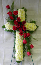 Love and Honor Red Rose Funeral Cross by Enchanted Florist Pasadena TX - 18 beautiful long stemmed red roses down the center of a floral cross covered in white poms. Honorable funeral flowers for someone you love. Funeral flowers delivered in Houston TX, Channelview TX 77530,  and surrounding area funeral homes. RM509