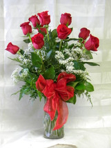 Delicious Dozen Long Stem Red Roses by Enchanted Florist Pasadena TX. Our real flower shops in Pasadena TX will deliver this beautiful bouquet of one dozen red roses for any occasion. Choose the best, choose Enchanted! RM351