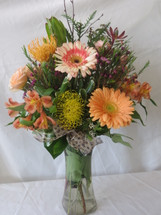 Wild Nectarine Protea and Gerbera Bouquet by Enchanted Florist Pasadena TX will make them go wild! Orange gerberas and tropical proteas with peach spray roses hand delivered today by a real florist in Houston TX, Deer Park TX, Webster TX and surrounding areas. Call now or order flower flowers online for Flower delivery Houston.  RM153