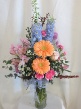 Spring Time Romance Pastel Flower Arrangement by Enchanted Florist Pasadena TX. Romantic pastel flowers in a clear glass vase. Send flowers online and get same day delivery in Houston TX and surrounding areas.  RM160
