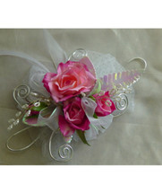 Pink Rose White Iridescent Silver Trimmed Prom Flowers Corsage by Enchanted Florist Pasadena TX. Pink spray roses in a wrist prom corsage with white iridescent and silver trim bling. PROM101