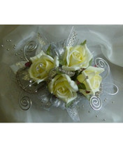 White Rose Silver Trimmed Blinged Out Prom Flowers Corsage by Enchanted Florist Pasadena TX. White spray roses in a wrist prom corsage with silver trim bling. PROM102