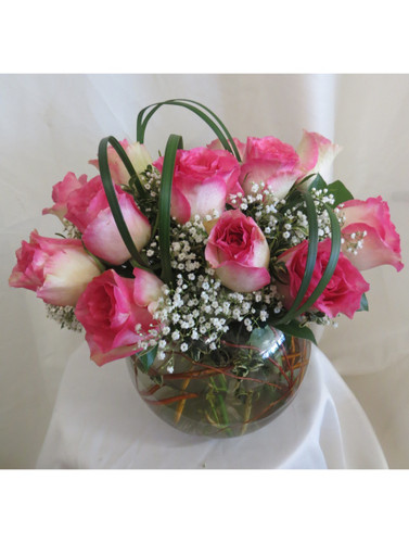 """Delectable Dozen Pink Roses in a Bowl by Enchanted Florist Pasadena TX.  One dozen pretty variegated hot pink tipped crème roses designed by our talented design team in this 8"""" clear glass rose bowl and accented with tropical foliages and babys breath. RM361"""