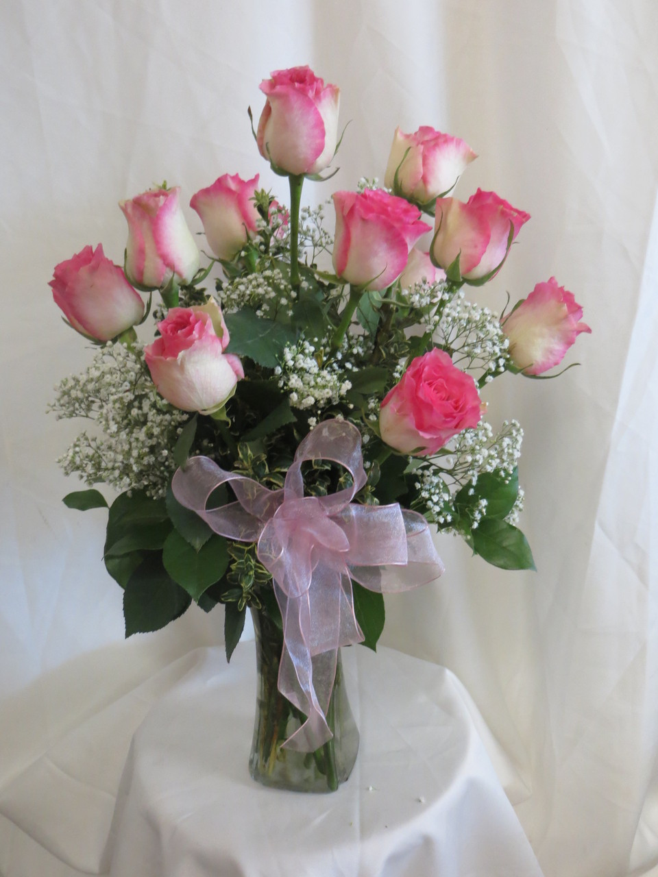 Beautiful vase of pink and white roses for delivery by flower delicious dozen pink long stemmed roses by enchanted florist deer park tx one dozen pretty reviewsmspy