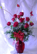 Fly Me Away Red Dozen Roses by Enchanted Florist Pasadena TX. Our premium Ecuadorian red roses in an upgraded vase with curly willow, butterfly, and exotic foliages. Red roses delivered in Houston TX.  RM352