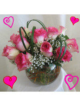 """Love Bowl of Pink Roses for Valentine's Day by Enchanted Florist Pasadena TX. One dozen pretty variegated hot pink tipped creme roses designed by our talented design team in this 8"""" clear glass rose bowl and accented with tropical foliages and baby's breath. RM904"""