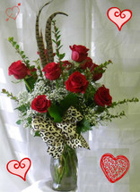 Red Leopard Dozen Roses for Valentines Day by Enchanted Florist Pasadena TX. Classic dozen red roses with a flair of leopard and feathers. Our premium Ecuadorian roses in red, with premium tropical foliages, baby's breath, pheasant feathers, and a wired leopard print bow. RM909