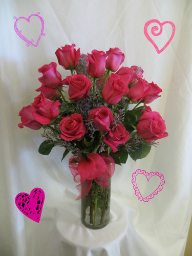 Two Dozen Hot Pink Roses for Valentines Day by Enchanted Florist Pasadena TX.  Romantic bouquet of lush hot pink roses arranged in a contemporary cylinder vase and accented with purple filler limonium. RM913
