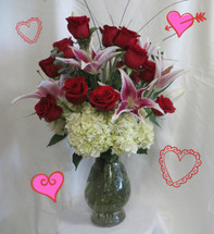 Ultimate Romance Dozen Red Roses for Valentines Day from Enchanted Florist Pasadena TX. It includes our upgraded Bella vase, white hydrangeas, fragrant stargazer lilies, dozen premium red Ecuadorian roses, eucalyptus, and bear grass for the flowy look. RM919
