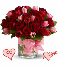 "PS I Love You Tulips for Valentines Day by Enchanted Florist Pasadena TX.  A romantic statement of love this Valentines Day. This PS I love you bouquet includes 12 classic roses, 10 pink tulips, 10 red tulips all expertly arranged in a clear cylinder tied up neatly with a beautiful pink bow.  RM941      Approx 14""W x 13""H"