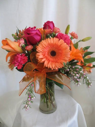 Our beautiful Luscious Hot Pink & Orange Gerbera Bouquet is a beautiful statement of love. This bright pink and orange bouquet of flowers includes hot pink roses and  carnations with orange lilies and gerbera daises for delivery in Webster TX and surrounding areas.  RM168