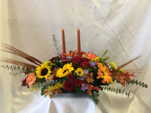 Thanksgiving Centerpiece with Candles from Enchanted Florist Pasadena TX. Don't dare leave your table bare this Thanksgiving holiday, flowers are a must have for the perfect table. RM208