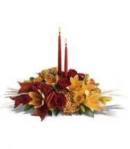 Graceful Glow Centerpiece from Enchanted Florist Pasadena TX. Fall flowers perfect for your fmaily dinner table. T168-1