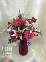 One Hot Momma Mothers Day Flowers by Enchanted Florist Pasadena TX is an all pink bright mixed flower bouquet in a hot pink vase. It includes fragrant stargazer lilies, hot pink gerbera daisies, light pink pixies, and more pink flowers. A proclamation of love for the woman who raised you. RM803